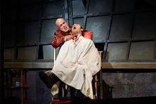 Tom Ford (left, as Sweeney Todd) dispatches another victim, actor Alex Syiek (right)