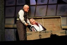 Tom Ford (left, as Sweeney Todd) dispatches his first victim, actor Mark G. Hawbecker (right, as Adolfo Pirelli)