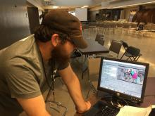 7/22/18 Kevin Smith editing the official Cleveland GiveCamp 2018 video. Note that the photo on the screen is of the Social Media Team with Kevin Smith and Stuart Smith.