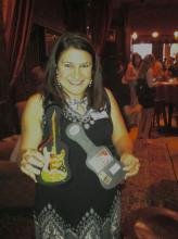 Crystal @EatDrinkClev won mini guitar prize!