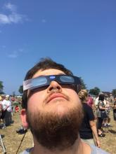 Kevin Smith with his eclipse glasses
